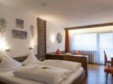 Doppelzimmer mit Wohnecke