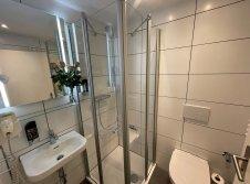 Einzelzimmer Komfort Plus Badezimmer
