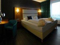 Komfort-Vierbettzimmer mit Balkon, Quelle: (c) Amedia Hotel Zwickau